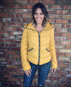 Mustard Puffer Jacket with Black Stitching and Gold Zippers, Pockets and a Hide-away Hood