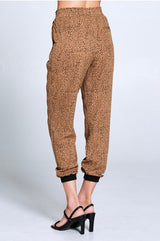 Leopard Print Joggers Features An Allover Leopard Print, Elastic Drawstring Waist, Front Slanted Patch Pockets, and Back Mock Pockets.  Ships from the USA, unique style, Fall fashion trends, chic, classic jogger, Ellison