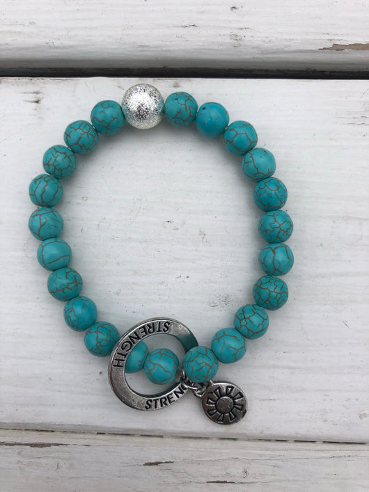 Handmade Beaded Bracelet - Crackled Turquoise Beads w/Strength Circle Charm & Sun Charm