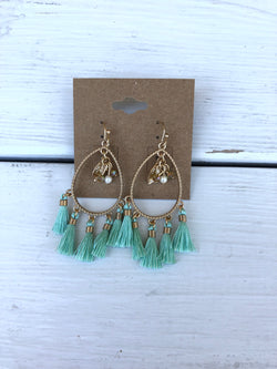 Turquoise & Gold Tassel Fish hook EarringsTake your outfit to the next level with OC Social Butterfly's accessory collection. Our collection of earrings is one of a kind. Simple, beautiful and elegant pieces can complete any look. Ships from the USA, unique style, fashion trends, jewelry