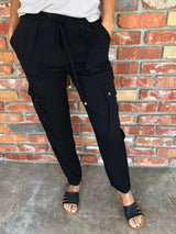 Black Cargo Pant with Drawstring Waist Tie is 100% Rayon  Take your outfit to the next level with OC Social Butterfly's hand selected, specially curated stylish pants. You can't go wrong a great pair of distressed skinny jeans, comfy joggers or linen pants.  Ships from the USA, unique style, fashion trends,