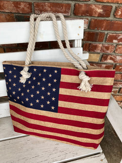 Vintage American Flag Tote Bag is a great carry all tote. OC Social Butterfly brings together a specially curated collection of clothing and accessories. From the latest trends to the most comfortable everyday attire at an affordable price.   Large Zipper Tote and ships from the USA, OC Social Butterfly boutique, USA bag, rope straps, 4th of july, style bags, pool bag, beach bag, lake bag