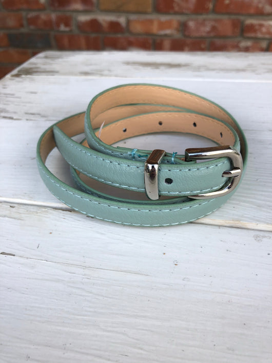 Turquoise Thin Belt with Gold Buckle  You can't go wrong adding a cute belt to any outfit. Check out our latest stylish belts.  Ships from the USA, unique style, fashion trends, country girl, pop of color belts