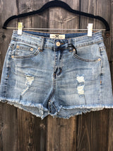 Light Blue Distressed Cut Off Shorts have comfort stretch fit by Hammer   Take your outfit to the next level with OC Social Butterfly's hand selected, specially curated stylish shorts. You can't go wrong a great pair of distressed denim shorts.  Ships from the USA, unique style, fashion trends, light blue denim shorts, stagecoach festival attire