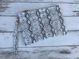 Black & Cream Snakeskin Clutch/Cosmetic Bag w/Strap   Our handbag collection is one of a kind. Looking for the perfect summer clutch, summer tote or handbag, we have what you are looking for.  Ships from the USA, unique style, fun fashion, animal print clutch, wristlet pouch