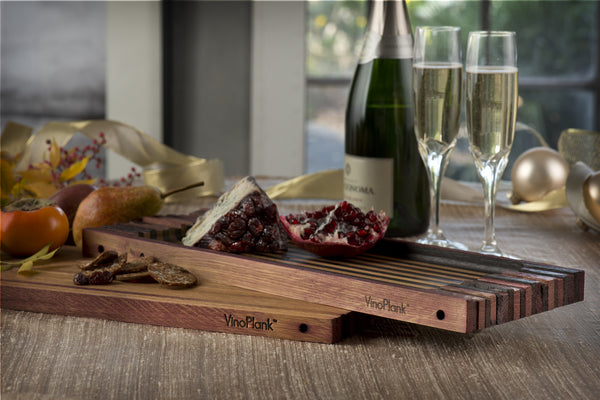 oak serving tray with cheese and champaign