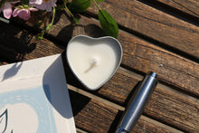 Candle in heart shaped tin