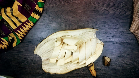 A sliced plantain in its skin