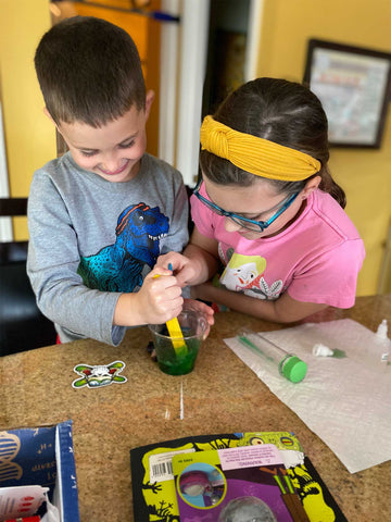 Kids doing experiments from their Club SciKidz Science Kit