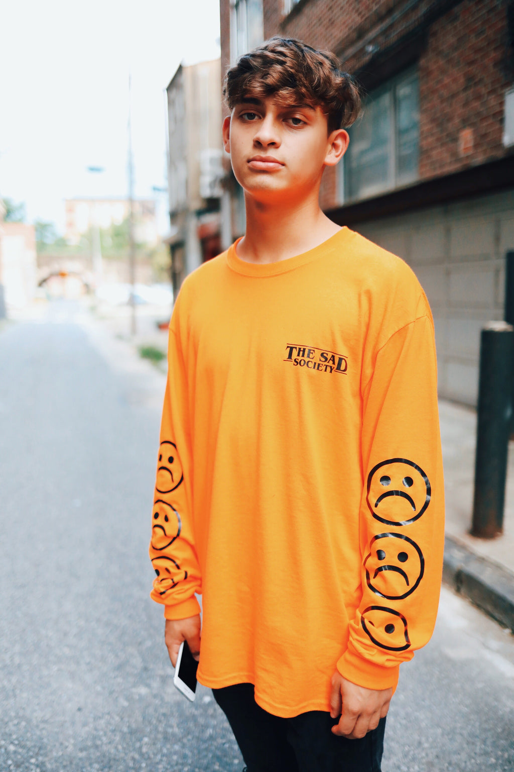 The Sad Society™ Sad Face™ Neon Orange Long Sleeve T Shirt