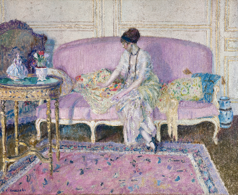 Woman Seated on Sofa in Interior by Frederick Carl Frieseke