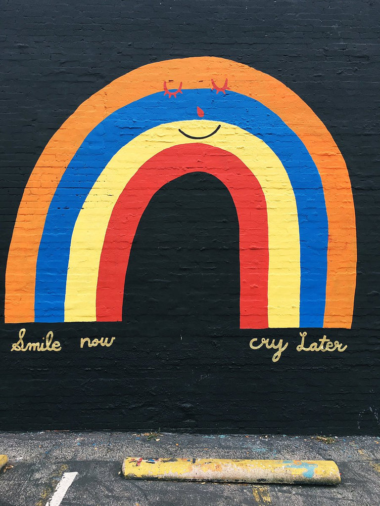 smile now cry later mural Austin