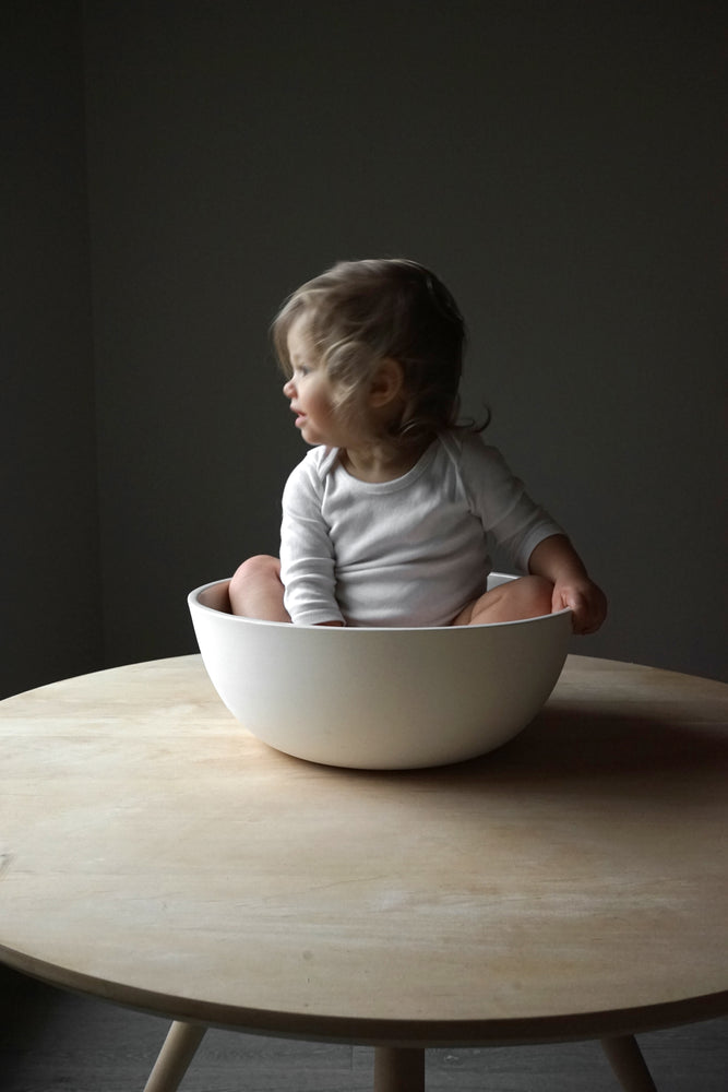 Load image into Gallery viewer, Baby sitting in white jumbo serving bowl..