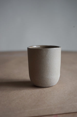Clay cup in grey finish.