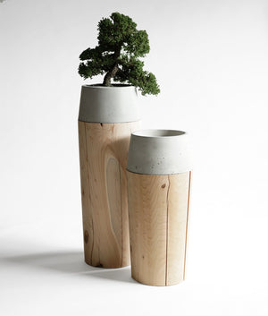 Large and small planter stands in concrete and wood finish.