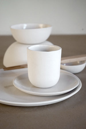 Dinnerware dish set in white finish.