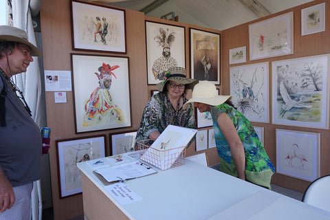 customers in Annie Moran art booth at New Orleans Jazz and Heritage Festival