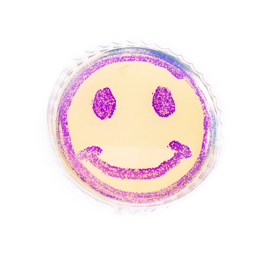 Smiley face bacteria painting made with Amino Labs Canvas kit for bioart, Petri dish art kit, microbial art kit for glowing bacteria, bacteria art, bacterial art, living art, STEM science project kit, sciart, great for middle school science, biology, high school, DIY bio, biohacking, home biotechnology