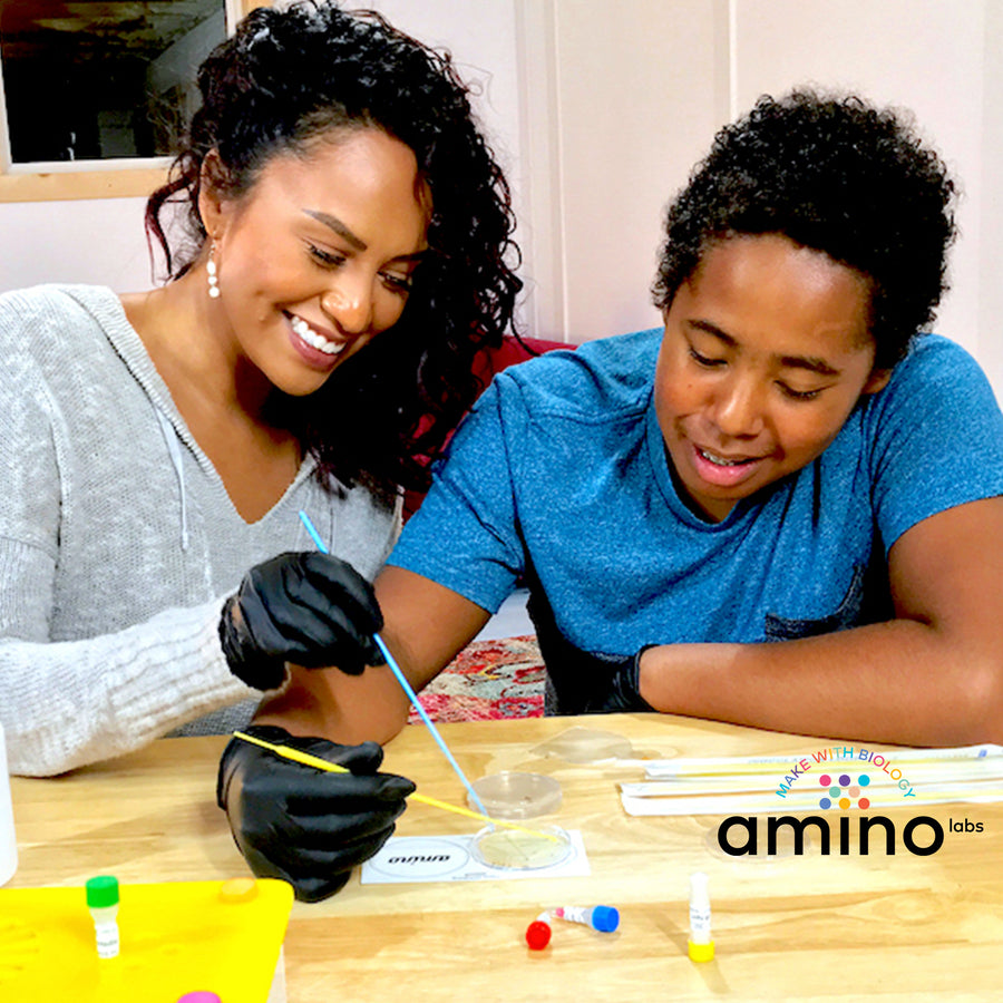 Family science experiments, STEM experiments as part of Amino Labs' Zero to Genetic Engineering hero starter pack -  Learn what is DNA, what is a gene, cell theory, genetic engineering, bioart, biotechnology, biohacking and genetic engineering with the world's first biohacking and biotechnology STEM beginner's starter kits