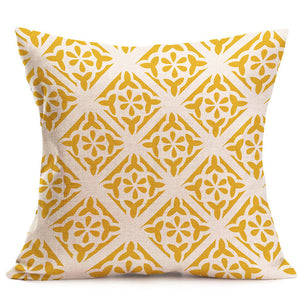 Yellow and white linen cushion