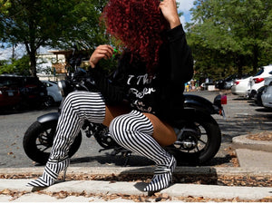 Set fashion trends. Shop CoccaBee Shoes online. Premier shoetique with trendy selections of the hottest boots and booties. These black and white stripped thigh high boots are a perfect fit for any outfit. Shop Carmen at CoccaBee shoes online.