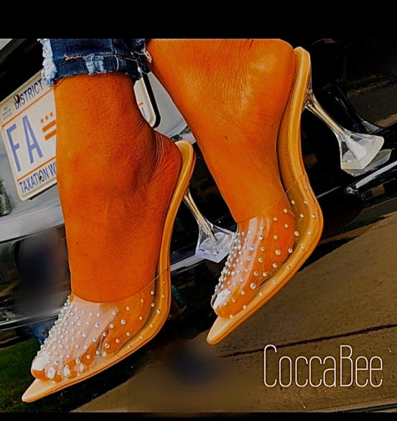 Clear heel embellished with crystals to add eye popping appeal. Corked heel adds a contemporary look and perfect stability. A shoe lover's dreams. Now shipping up to size 11 at Cocca Bee Shoes