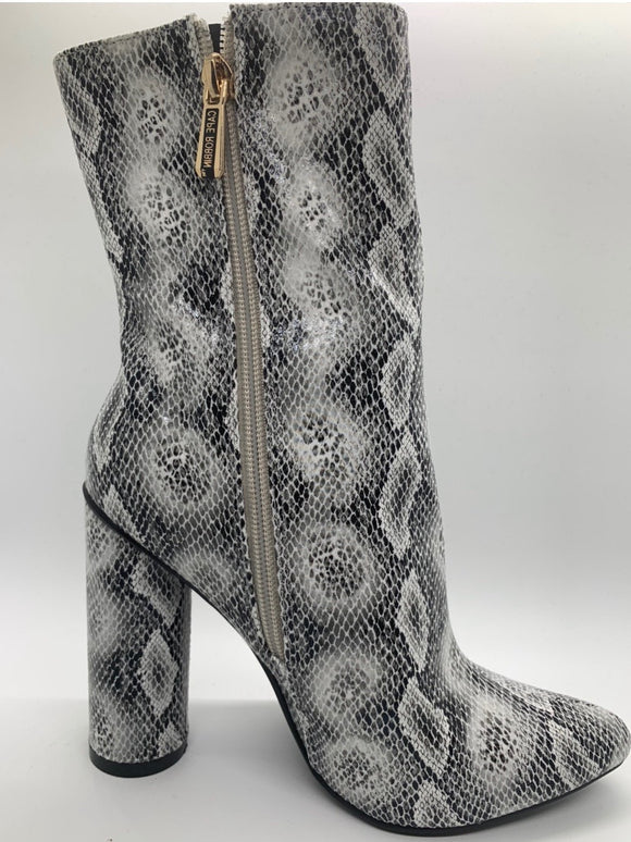 Paired with cropped jeans or tailored skirts, these booties are a stylish pick lofting your favorite looks on a trend-right block heel. A sleek sock silhouette and substantial block heel to elevate dressy looks. This snakeskin bootie with side zipper is the perfect bootie for every look.
