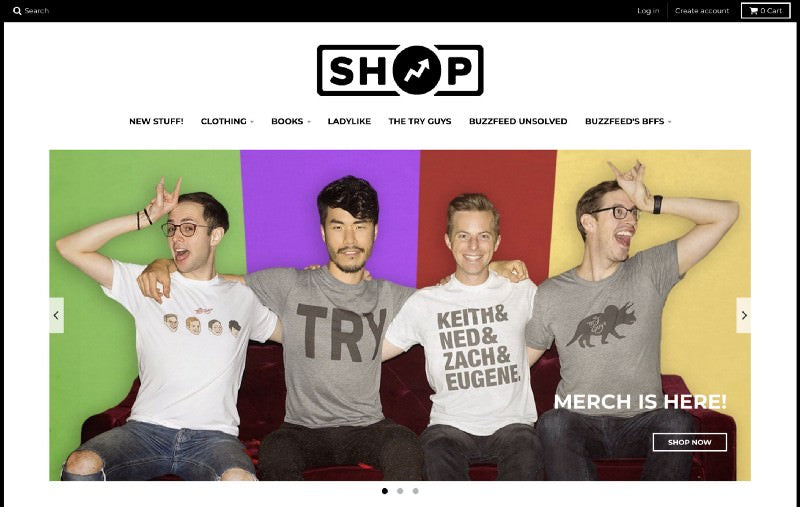 Buzzfeed shop header with four guys sitting on a couch wearing entertaining shirts