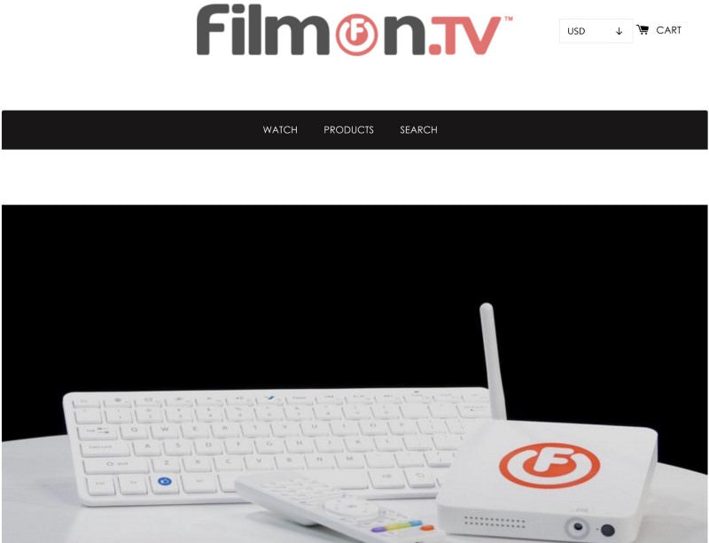 Filmon tv header showing a white keyboard, a white remote control and a white modem
