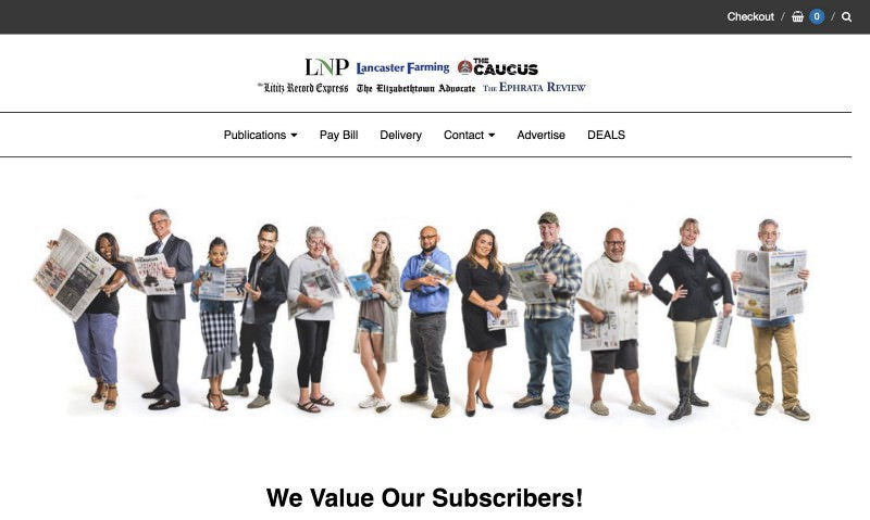 Lancaster online header with a diverse groups of happy subscribers holding their newspapers
