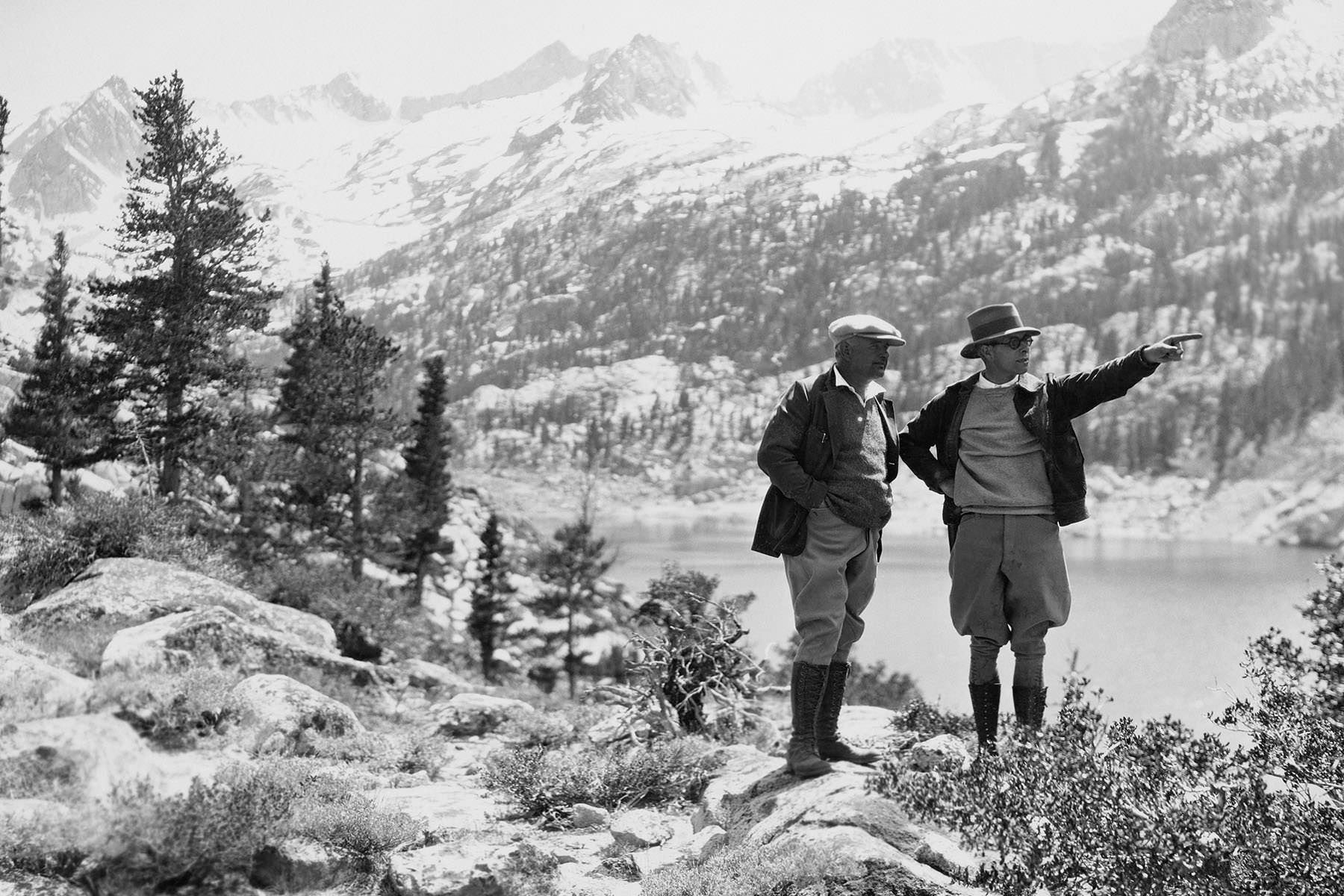 two explorers in wilderness on a black and white photo