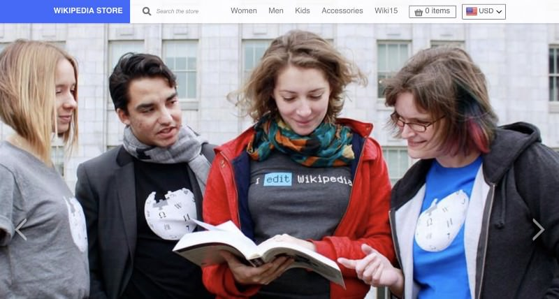 Wikipedia store site header with four people reading encyclopedia wearing wikipedia shirts