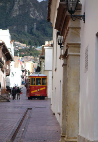 Amelia Rope Chocolate trip photo of hill in Bogota with small red tram