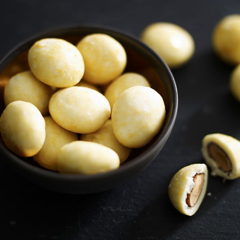 Amelia Rope Chocolate - Close Up Image for White Chocolate Coated Marcona Almonds with a Hint of Passion Fruit