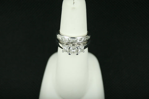 Ladies 3 Stone Princess Cut Engagement Ring With Channel Set Band