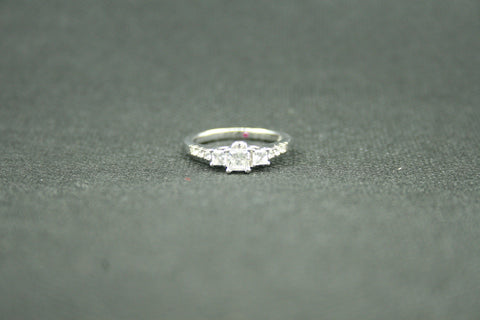 1.05ctw. 3 STONE PRINCESS AND ROUND DIAMOND ENGAGEMENT RING