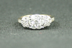 1.41ctw. ROUND DIAMOND FLOWER CLUSTER AND CHANNEL SET DIAMOND RING