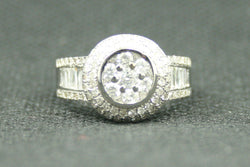 1.50 ctw. INVISIBLE SET CLUSTER ROUND DIAMOND AND BAGUETTE ENAGEMENT RING