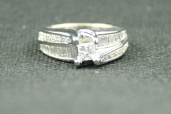 1.50 ctw. PRINCESS, ROUND, AND BAGUETTE DIAMOND BYPASS STYLE ENGAGMENT RING
