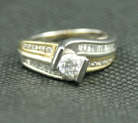 0.54 TCW TWO-TONE ROUND DIAMOND AND BAGUETTE FREEFORM ENGAGEMENT RING