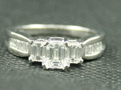 1.30 TCW EMERALD AND BAGUETTE 3 STONE PLATINUM ENGAGEMENT RING