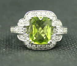 18K WHITE GOLD LARGE PERIDOT AND ROUND DIAMOND HALO STYLE RING