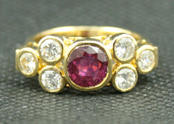 18K YELLOW GOLD ROUND RUBY AND DIAMOND RING