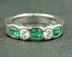 14K WHITE GOLD RADIANT CUT EMERALD AND ROUND DIAMOND BAND