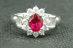 18K WHITE GOLD OVAL RUBY WITH ROUND AND BAGUETTE DIAMOND RING