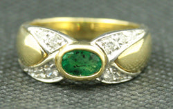 18K YELLOW GOLD OVAL EMERALD AND ROUND DIAMOND CRISS CROSS BAND