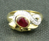 18K TWO-TONE GOLD OVAL RUBY AND ROUND DIAMOND FREEFORM RING