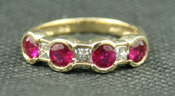 14K YELLOW GOLD ROUND RUBY AND PRINCESS CUT DIAMOND BAND
