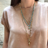 Layered necklaces worn on model