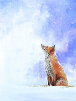 A red fox sits peacefully watching the snow fall.